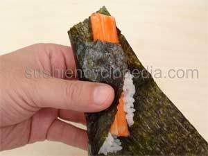 sushiencyclopedia.com - instructions for making sushi at home! This hand roll is part of the beginner lesson. :)
