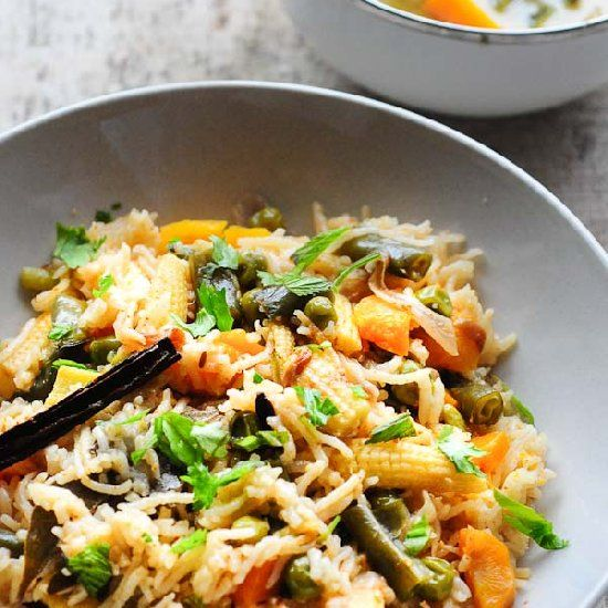 A one-pot vegetarian rice meal with lots of vegetables. If you have a rice cooker or pressure cooker, this takes under 30 mins!