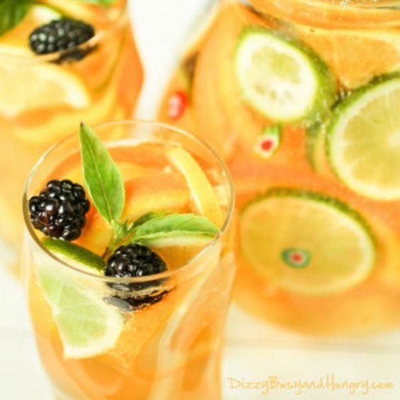... with lemon, lime, orange, pineapple chunks, wine, gin, ginger ale
