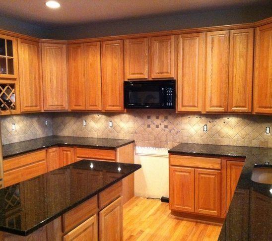 tile backsplash granite countertop oak colored cupboards light colored oak cabinets with. Black Bedroom Furniture Sets. Home Design Ideas