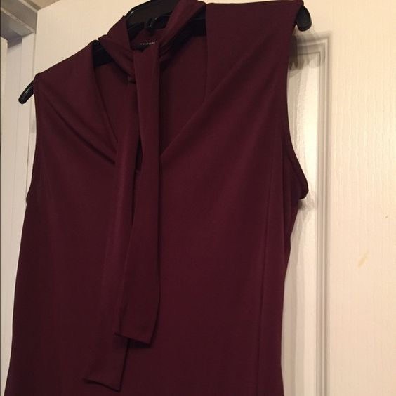 New York & Co Top Beautiful dressy sleeveless top in a rich burgundy/plum color! Has a tie around the collar, wear tied or open  New York & Company Tops