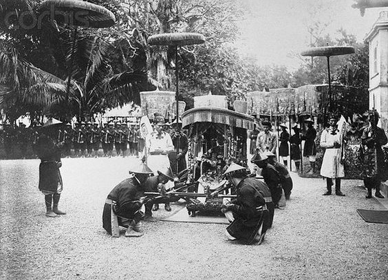 """""""14 Aug 1926, Annam --- Bearing the Emperor to the Palace Steps! Taking all care not to give the ruler a """"jolt"""" in letting down the """"royal carriage"""" these carries exercised great care. This photo shows the Emperor Khai-Dinh, in his palanquin, on his arrival at the royal palace steps, in Annam, in French Indochina after a fete held a few days ago. --- Image by © Bettmann/CORBIS"""""""