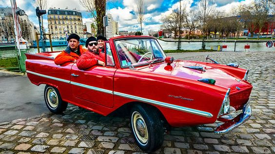 cruising through the streets of Paris in an Amphicar, a German car from the 1960s that acts as a car and a boat!