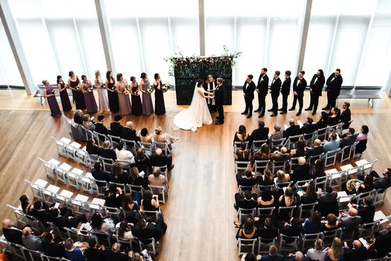 Mint Museum Uptown wedding in Charlotte, NC | wedding ceremony, museum wedding ceremony, indoor wedding, boxwood wall ceremony decor, curved ceremony seating