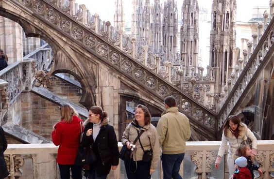 Walk amidst the Gothic spires and gargoyles on the roof of the Duomo Cathedral in Milan.