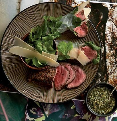 Seared beef rolled in rocket and rice paper.
