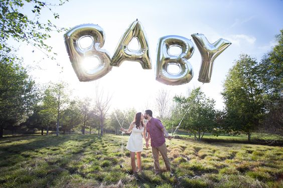 Pregnancy Announcement by Tulips and Tangerines Photography - mylar oversized alphabet balloons