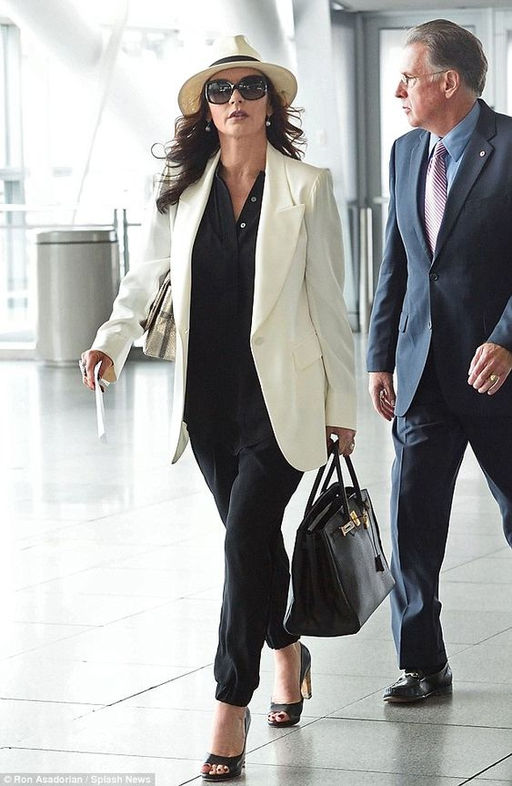 Strutting through the terminal: The 46-year-old Oscar winner looked luxurious toting an He...