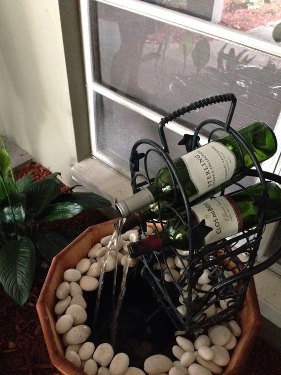 Wine Bottle Water Fountain You Can Make One Like This From Old Wine Bottles And A 20 Wire Wine Rack Www Wine Bottle Fountain Diy Water Fountain Diy Fountain