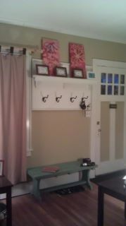 Old Dresser mantle, a board from Ace Hardware, some brass hooks and a very handy man ;) Built in entry way!
