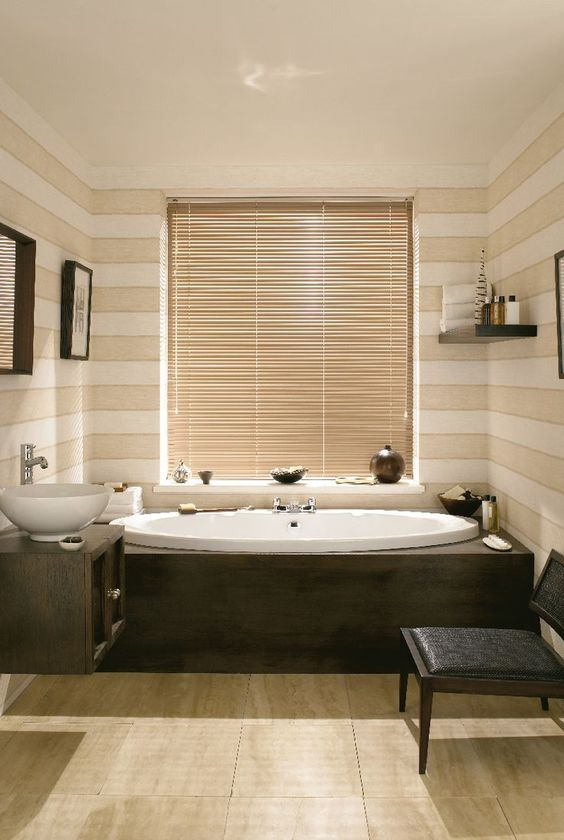 Use wood tones and whites to create a spa feel within a bathroom. Add a pop of colour with a made to measure Venetian blind in a brighter neutral shades which matches your decor. Our Chestnut aluminium Venetian blind is perfect! www.hillarys.co.uk