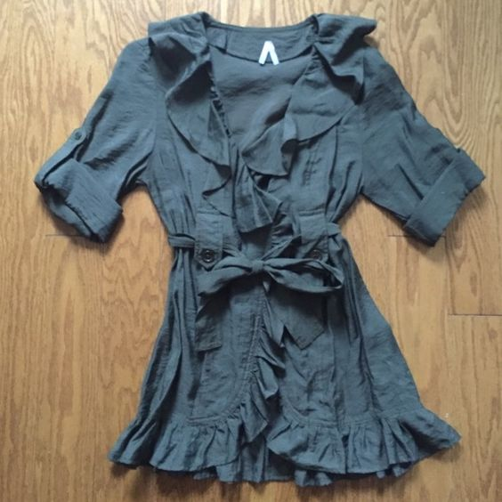 Olive Green Ruffle Jacket Very cute with dark jeans or pants! This pre loved jacket is very lightweight. There is a button on the front, and buttons on each sleeve to keep them rolled. Jackets & Coats Blazers