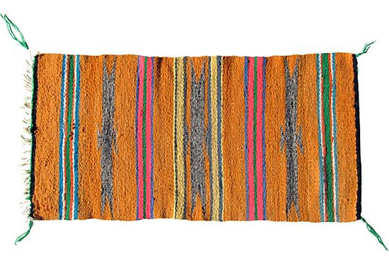 @onekingslane the orange Navajo Gallup Rug is a site to behold. Bright orange with greys, blues, greens and pinks Spruce up any room with a smile