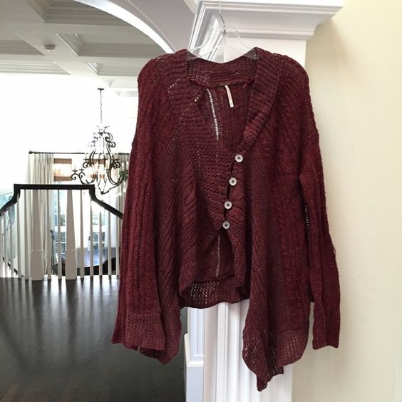 Free People || Chunky Asymmetrical Cardigan 1-DAY HOLIDAY SALE This cardigan is so soft + cozy! It has a cute draped fit (slightly longer on the sides) + can be buttoned or left open. This looks great over a long top with black leggings + a pair of laced up boots. The color is a dark reddish/burgundy. Worn several times & there is noticeable signs of wear (mostly on button holes, when unbuttoned) but still in good condition.  ⭐️Sizing: Fits sizes M/L. Free People Jackets & Coats