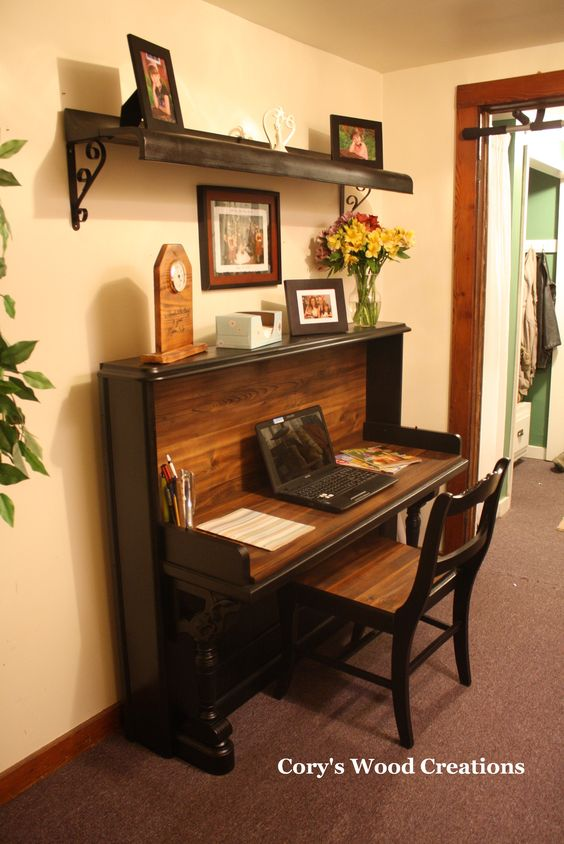 Re-purposed piano into desk with matching chair and if you notice the shelf is made from the key cover....by Cory's Wood Creations.