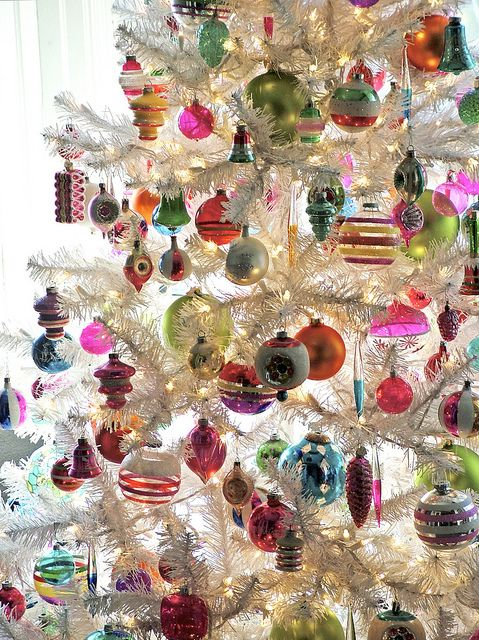 pretty vintage ornaments on a white christmas tree
