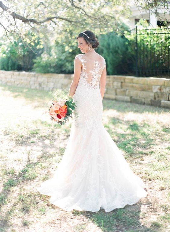 Classic wedding dress with illusion lace back | Image by Sophie Epton Photography