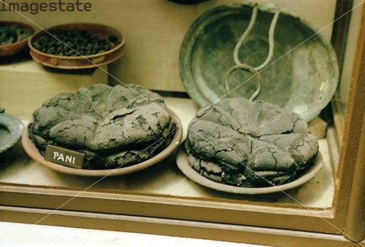 Roman bread from Pompeii, Italy. Pompeii was buried under a thick layer of volcanic ash by a catastrophic eruption of Vesuvius in 79 AD. The site of the town was rediscovered in 1748, and subsequent excavations revealed buildings and artefacts in a remarkably well preserved state.