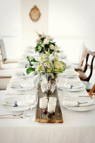 We love the look of a wood strip to center the table settings. Click through for more ideas!