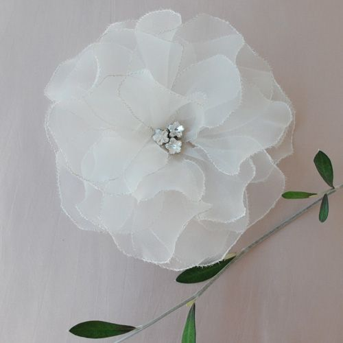 Ivory silk organza flower with silver thread stitched petals and crystal cabouchon centre available from www.nancyandflo.com: