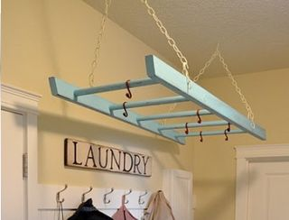 This would not only be awesome in a laundry room, but you could put hooks on it to hang pans OR you could hang hangers directly on it if you don't have a closet or put in a garage for winter coat storage, just cover them with garbage bags before. You could put a board on top and use for other storage, need the ladder? empty it and use it!