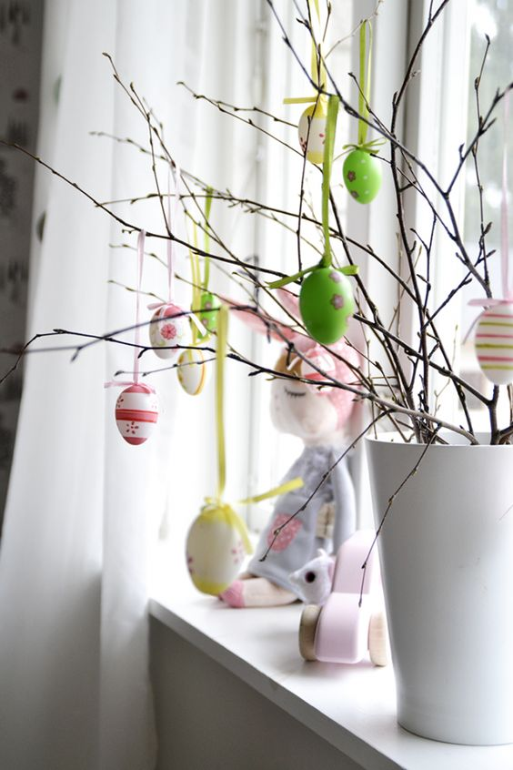 Scandinavian Easter tree - Handpainted eggs on twigs. More Easter ideas on Littlescandinavian.com: