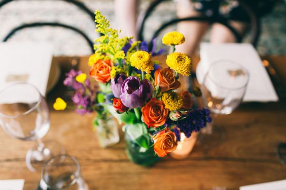 Simple floral centerpieces from Lauren and Eric's Hip Brooklyn Restaurant Wedding. #simplewedding