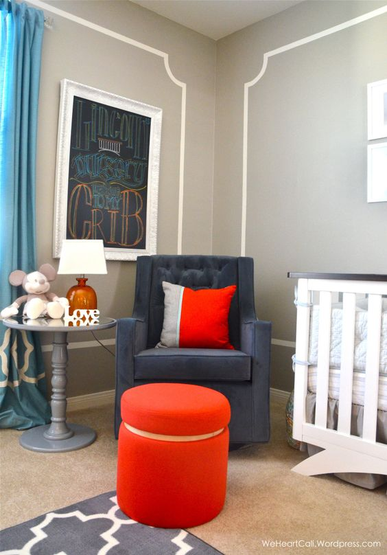 The wall framing in this nursery is such a simple way to give the room an upscale touch. (Paired with the Newco Magical Harmony Bella Velvet Grand Glider - we're in LOVE!) #nursery: Side Table, Orange, Target Nurserystorage, Nurserystorage Graynursery, Gray Rooms, Grey, Baby, Boy