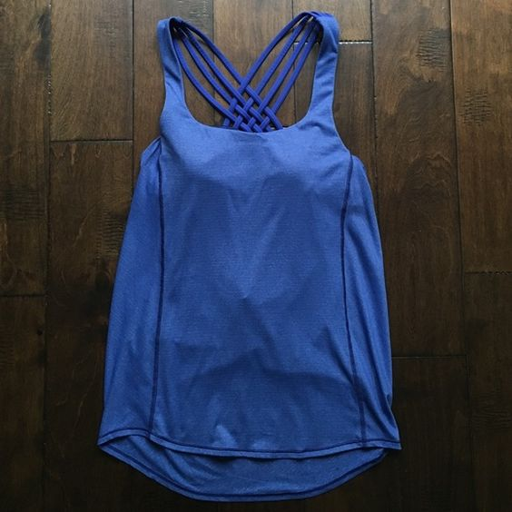 Lululemon blue Wild Tank <New!> New Lululemon blue wild tank with draped open back and built-in bra--perfect for barre and yoga. Bright blue, size 6. Long length and strappy bra with great coverage. Brand new (no tags). It didn't fit me and received as gift. lululemon athletica Tops Tank Tops