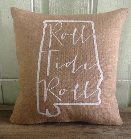 """Christmas gifts for Alabama Crimson Tide football fans. For the home decorator. These burlap """"Roll Tide Roll"""" pillows from the TwoPeachesDesign Etsy shop would be great for those going for the shabby chic aesthetic, while this one-of-a-kind ceramic piece could give a subtle nod to UA fandom in a more classic office or living room."""