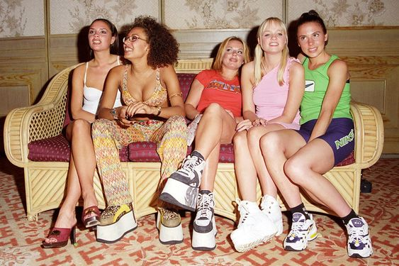 Spice Girls pose for a photo in Bali in 1997 wearing Buffalo London sneakers. By John Stanton/WireImage.