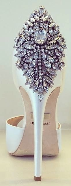 Add a little bit of bling to the wedding with Badgley Mischka lovely satin shoes.