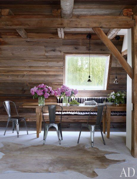 The dining area of film director Shawn Levy's modern farmhouse in Hudson Valley, New York, which was renovated by Bonetti/Kozerski Studio.