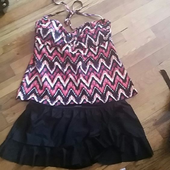 Swimsuit 2 piece, bottom piece is a skirt.Brand new, but without tags. Swim