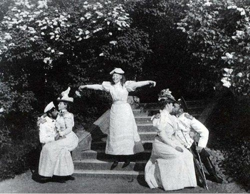 'Kiss in the Park'    Pair on the right is Nicholas and Alexandra, young lady between the pairs is Grand Duchess Olga (sister of Nicholas)