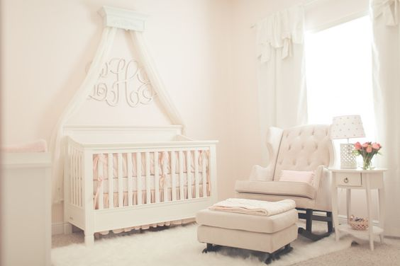 Simple, Chic Light Pink Nursery - love the mod glider and monogram over the crib!