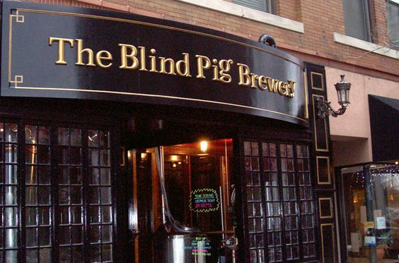 """The Blind Pig Brewery. """"The 'Pig is gritty, dark, and distressed inside, as any good watering hole should be."""" Great selection, intimate atmosphere, and always a good time.  Extra Pale Ale, Ordinary Bitter, & Oatmeal Stout are currently on tap!"""