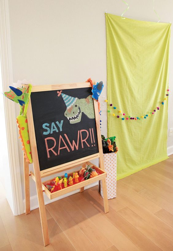 Dino MITE Dinosaurs & Reptiles Birthday Party photo booth set up
