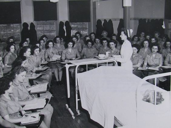 Hospital Ward. Navy WAVES demonstrating the word of pharmacists' mates.