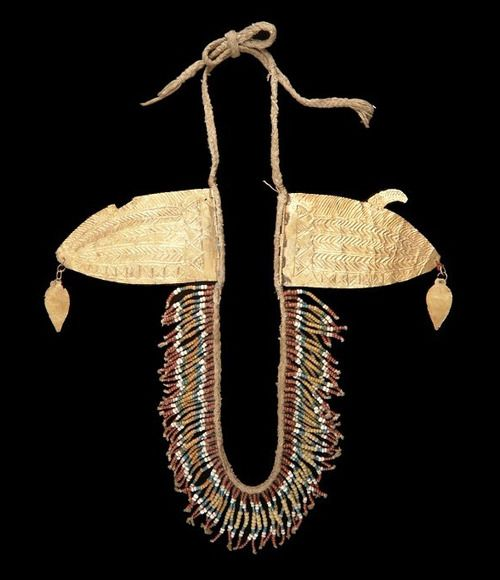 Indonesia ~ Small Sunda Islands   Chin ornament; composted of two gold plates placed near to the ears, the plates are connected with a string of glass beads that hang under the chin. Repousse work on the gold plates   Sumba Island, Nusa Tenggara Timur province   ca. 19th - 20th century