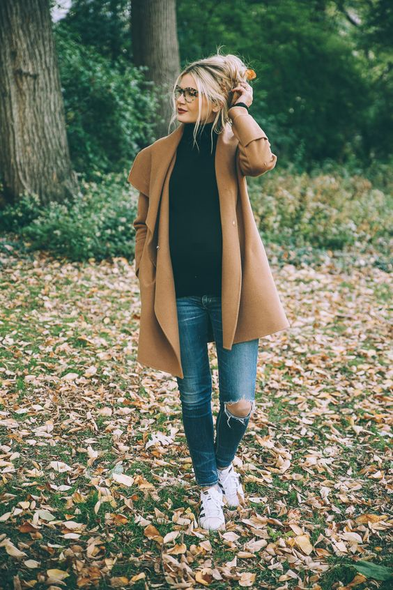 ripped denim, camel jacket, black turtle neck:
