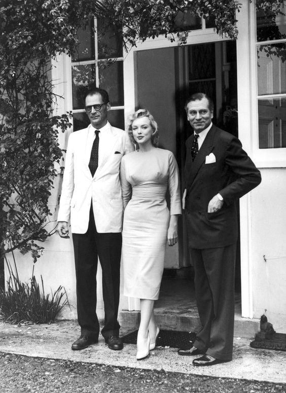 Marilyn Monroe, Arthur Miller and Laurence Olivier after their arrival in England at Parkside House in Egham, 1956.