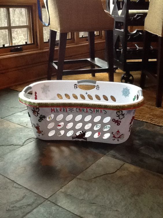 Christmas gift laundry basket great for less trips putting presents in it so easy just get an old laundry basket and decorate it