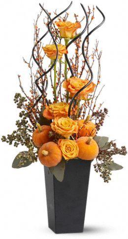 Halloween/Fall flower arrangement. Get flowers at http://www.flowerexplosion.com/