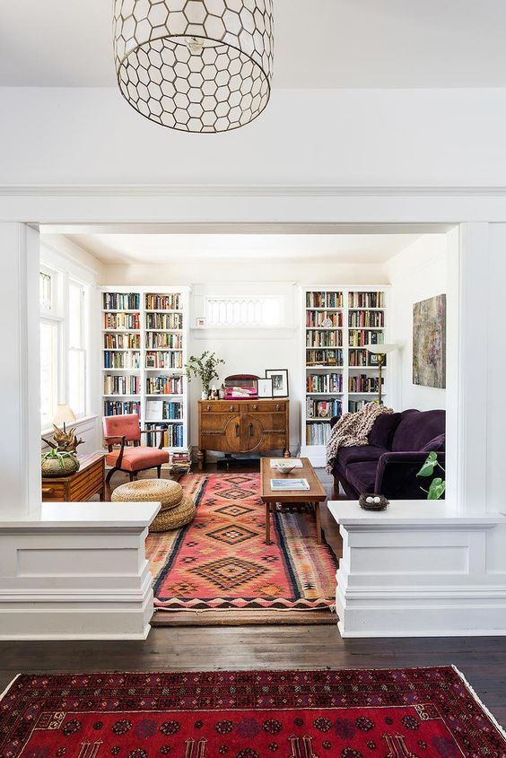 similar style rugs connect rooms