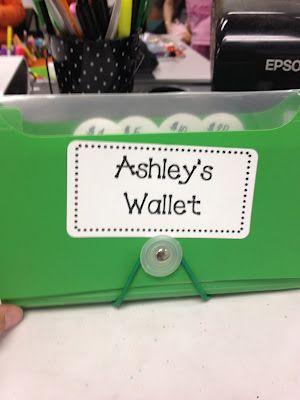 Classroom economy using checks, checkbook, play money, and classroom store.