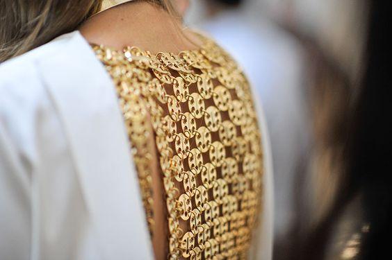 Metal dress of a model at Paris fashion week