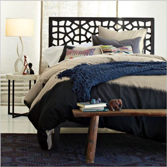 Love this combination of navy area rug and textured bedding and of course the great headboard. To see more unique headboards click through on image...