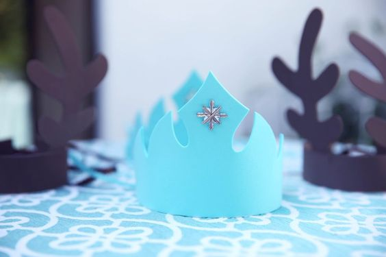 Pin for Later: Let It Snow! A Fabulous Frozen Fourth Birthday Party Foam Elsa Crown Dress up plain foam crowns by gluing on a little shimmer.
