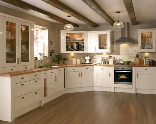 Kitchen Ideas With Cream Cabinets white cabinets, wood counters, cement floor teal walls | decor